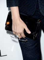 Nancy Meyers' studded black patent leather clutch at the Elle Women in Hollywood celebration was a perfect blend of edgy and stylish.