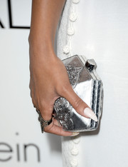 Meagan Good stepped up the elegance with this filigree-embellished metallic clutch at the Elle Women in Hollywood celebration.