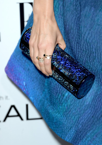 Ahna O'Reilly glammed it up with this bedazzled blue tube clutch by Jimmy Choo at the Elle Women in Hollywood celebration.