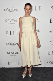 Michelle Monaghan styled her dress with ultra-chic white laser-cut pumps by Christian Louboutin.