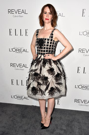 Sarah Paulson decked herself out in a show-stopping black-and-white cocktail dress by Oscar de la Renta, featuring feathered flowers on the skirt, for the Elle Women in Hollywood event.