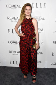 Gillian Jacobs added shine via a metallic gold clutch.