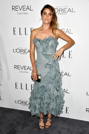 For the Elle Women in Hollywood event, Nikki Reed adorned her curves with a slate-blue Marchesa strapless dress featuring cascades of ruffles.