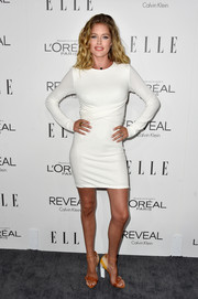 Doutzen Kroes proudly showed off her post-baby figure in a body-con LWD during the Elle Women in Hollywood event.