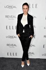 Brie Larson opted for a black Calvin Klein pantsuit teamed with a white shirt when she attended the Elle Women in Hollywood event.