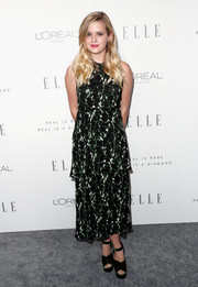 Ava Phillippe paired her dress with dark green cross-strap platforms.