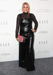 Busy Philipps teamed black BreeLayne leather overalls with a sheer turtleneck for Elle's Women in Hollywood celebration.