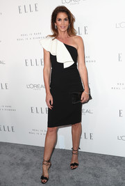 Cindy Crawford teamed her dress with chic black ankle-tie sandals.