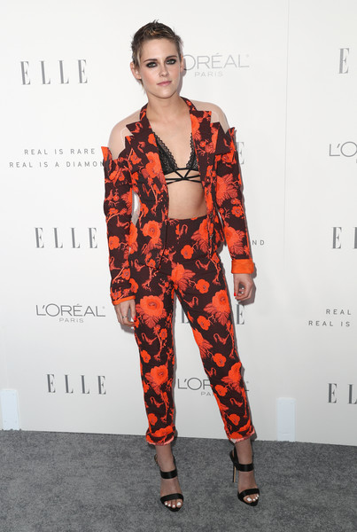 Kristen Stewart looked funky in a cold-shoulder floral pantsuit by Antonio Berardi during Elle's Women in Hollywood celebration.