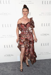 Juliette Lewis teamed her dress with a pair of embellished brown peep-toes.