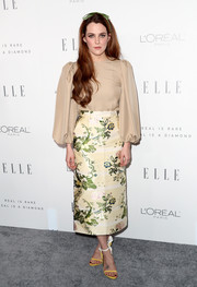 Riley Keough went the demure route in a nude Calvin Klein top with blouson sleeves during Elle's Women in Hollywood celebration.