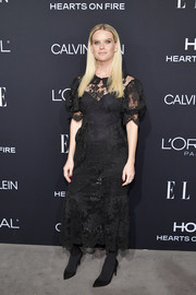 Alice Eve kept it understated in a black lace midi dress by Simone Rocha at the 2018 Elle Women in Hollywood celebration.