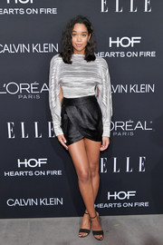 Laura Harrier's black crossover mini skirt added a dose of sex appeal.