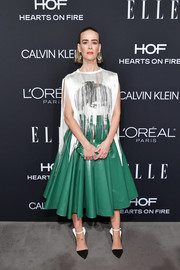 Sarah Paulson completed her edgy look with a pair of black-and-white wing-back pumps by Calvin Klein.