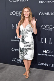 Camilla Luddington attended the 2018 Elle Women in Hollywood celebration wearing an abstract-print slip dress.