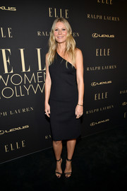 Gwyneth Paltrow completed her look with strappy black heels by Jimmy Choo.