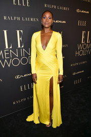 Issa Rae looked striking on the black carpet in a plunging yellow gown by Ralph Lauren at the 2019 Elle Women in Hollywood celebration.
