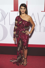 Monica Cruz continued the vampy vibe with a pair of black lace-up heels.