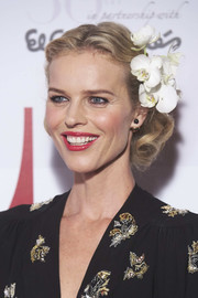 Eva Herzigova wore her short curls pinned back, complete with white orchids, during the Elle 30th anniversary party.