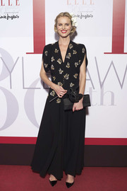 Eva Herzigova was vintage-chic in a black Dior Couture gown with a metallic-embroidered bodice during the Elle 30th anniversary party.