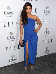 Priyanka Chopra paired her dress with a mirrored, geometric hard-case clutch by Rauwolf.