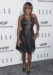 Viola Davis looked foxy at the Elle Women in Television dinner in a plunging black mesh dress by Carmen Marc Valvo.