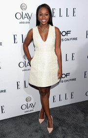 Aja Naomi King was classic and cute in a sleeveless, V-neck LWD by Alice + Olivia at the Elle Women in Television dinner.