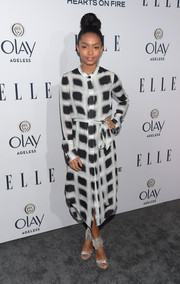 Silver Via Spiga sandals with fringed ankle straps finished off Yara Shahidi's look in ultra-glam style.