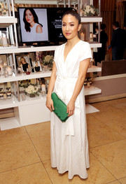 Constance Wu gave her look a pop of color with a scalloped green clutch by Kate Spade.