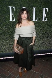For her footwear, Kathryn Hahn kept it comfy in camel-colored mules.