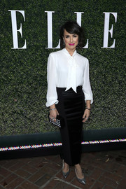 A black-and-white patterned box clutch tied Constance Zimmer's look together.