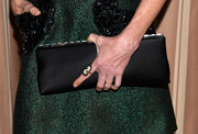 Julie Bowen carried a cute satin clutch by Jimmy Choo.