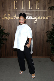 Kiersey Clemons kept it minimal in a loose white blouse at the Elle & Ferragamo Hollywood Rising celebration.