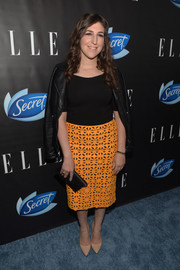 Mayim Bialik teamed an orange cutout pencil skirt with a black leather jacket for the Elle Women in Comedy event.