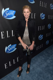 Julie Bowen layered a black velvet jacket over a beaded gold top for the Elle Women in Comedy event.