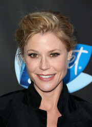 Julie Bowen attended the Elle Women in Comedy event wearing a casual, messy updo.