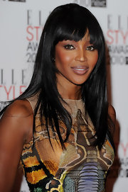 Naomi showed off her sleek black locks at the ELLE Style Awards. Her blunt cut bangs were the perfect thing to frame her face.