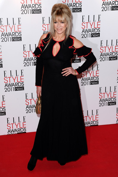 Arriving at the 2011 Elle Style Awards in London, Jo Wood worked a black cut-out dress complete with red ruffle detailing.