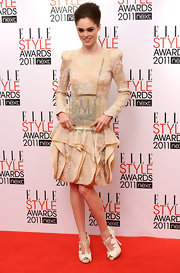 Coco Rocha donned an intricate cream embroidered frock. She topped off the look with white strappy sandals complete with T-strap detailing.