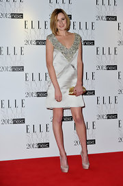 Laura topped off her mini dress with nude satin platform pumps.