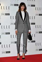 "Alexa Chung topped off her plaid suit with classic black ""Pigalle"" stilettos."
