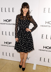 Zooey Deschanel went for vintage cuteness at the Elle Women in Television celebration in a black-and-white polka-dot dress by Dolce & Gabbana.
