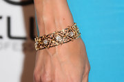 Kim Raver adorned her wrist with an intricate gold and diamond bracelet at the ELLE's Women in Television Celebration.