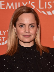 Mena Suvari went for a simple straight hairstyle and minimal makeup at the Emily's List pre-Oscars brunch.