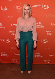 Chelsea Handler went for a striking color combo with this high-waisted green pants and blush blouse combo.