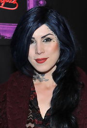 Kat Von D offset her wingtip eyeliner with deep red lipstick.