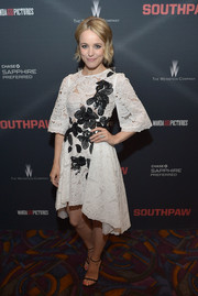 Rachel McAdams looked sweet and ladylike at the 'Southpaw' screening wearing this Zuhair Murad cocktail dress in white lace with contrasting black floral embroidery.