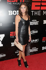 Hope Solo kept her tough vibe in a pair of black suede peep-toe booties.