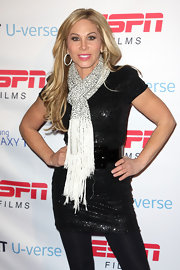 Adrienne Maloof chose a glittery black-and-white ensemble for the ESPN event, consisting of an LBD and a fringed scarf.