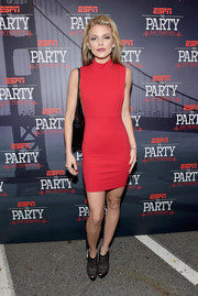 AnnaLynne McCord styled her dress with chic black cage booties by Christian Louboutin.